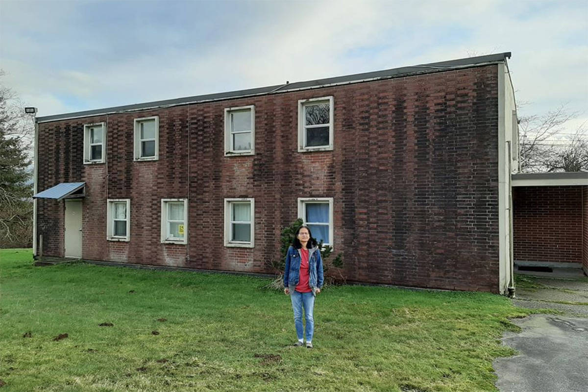 Maggie Smith on Feb. 2, 2020 in front of the building she lived in as a young girl from 1968 to 1971 at St. Mary's Residential School in Mission. (Facebook)