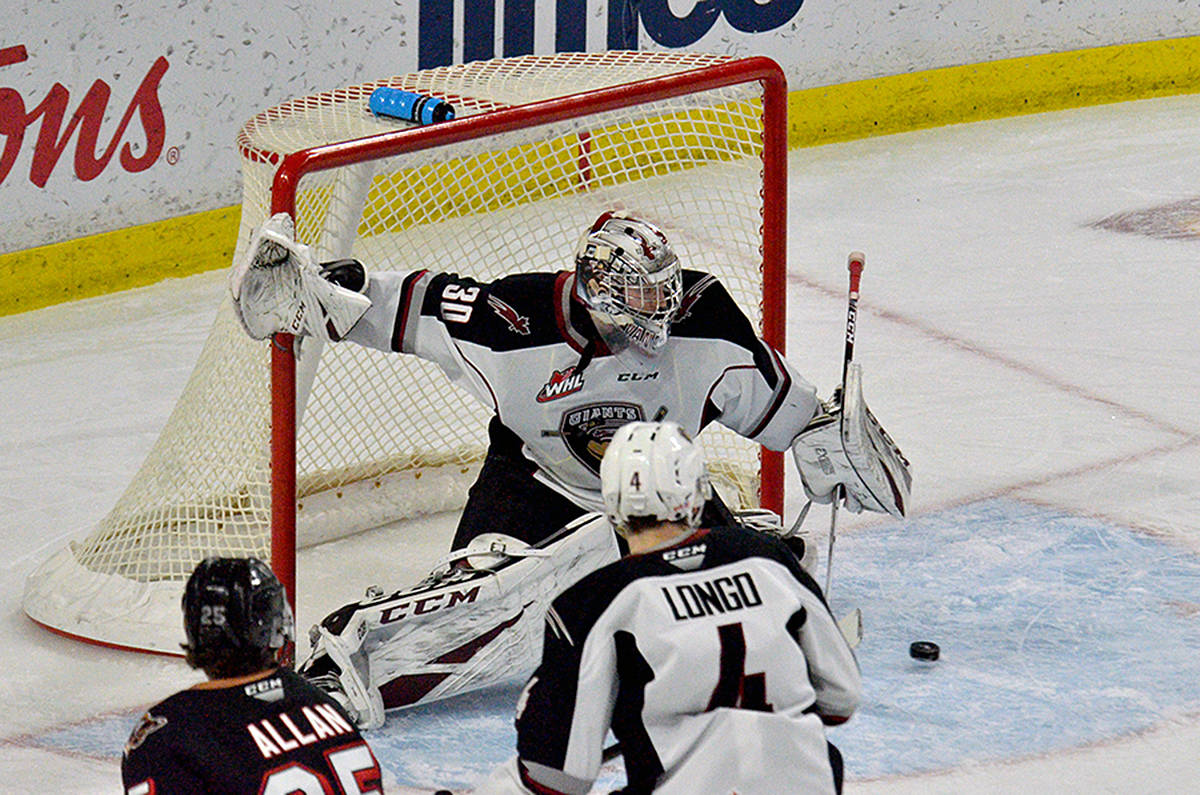 Giants goaltender David Tendeck blocked a shot during Friday night's 6-5 win over the Calgary Hitmen at the Langley Events centre (Gary Ahuja/special to Langley Advance Times)