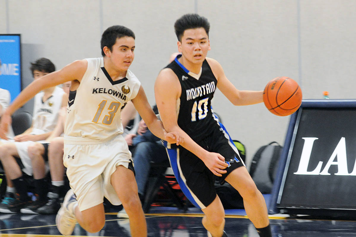 R.E. Mountain's Evan Lee was pursued by a Kelowna player during opening action at the 2020 Junior Boys Basketball Provincial Invitational Tournament at the Langley Events Centre on Saturday, Feb. 22. (Dan Ferguson/Langley Advance Times)