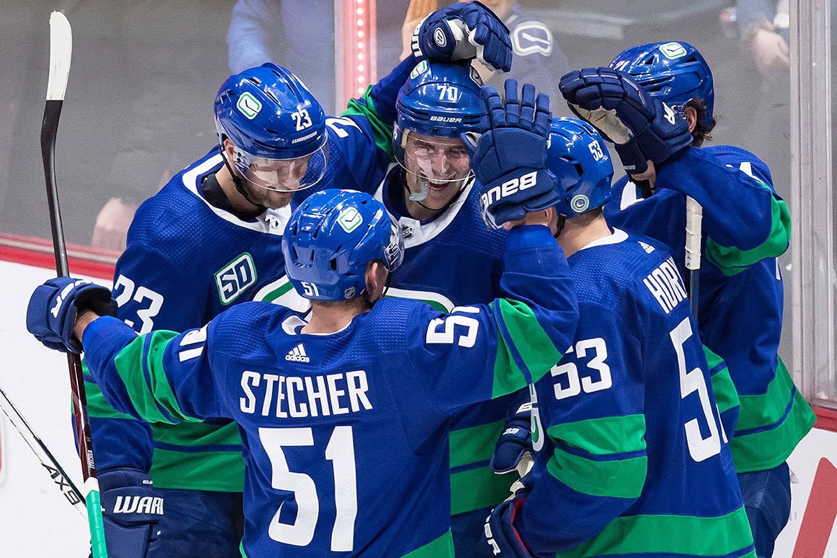 Vancouver Canucks' Alexander Edler, of Sweden, from left to right, Troy Stecher, Tanner Pearson, Bo Horvat and Loui Eriksson, of Sweden, celebrate Eriksson's goal against the Boston Bruins during the second period of an NHL hockey game in Vancouver, on Saturday, February 22, 2020. THE CANADIAN PRESS/Darryl Dyck