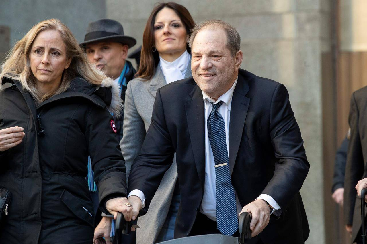 Harvey Weinstein arrives at a Manhattan courthouse during jury deliberations in his rape trial, Monday, Feb. 24, 2020, in New York. (AP Photo/John Minchillo)
