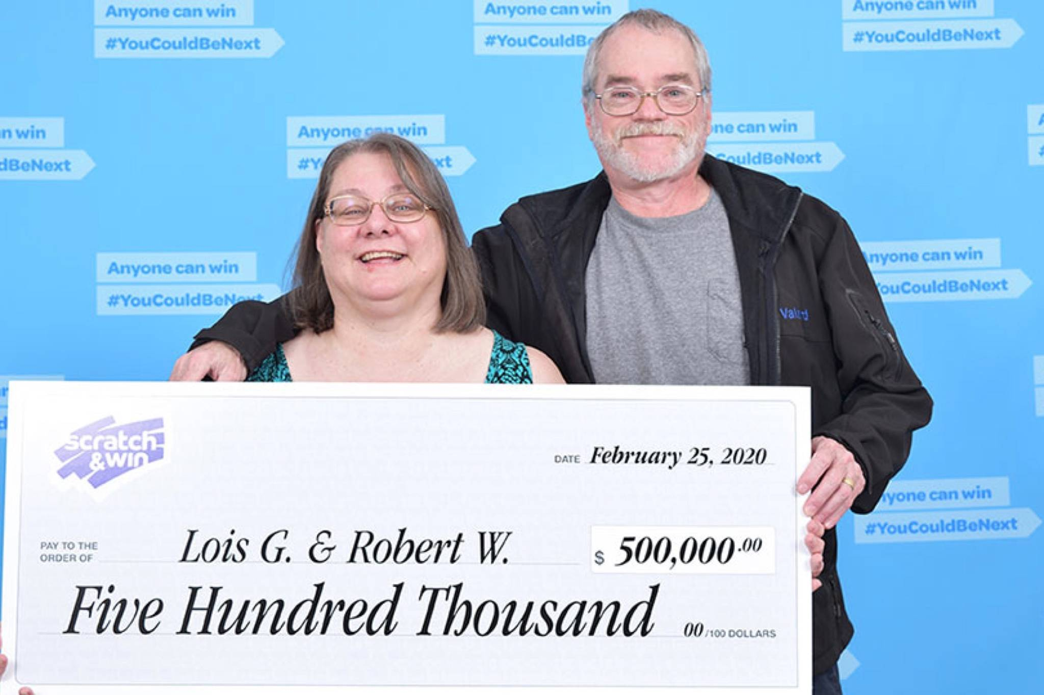 Lois Gueret and Robert Walters pose with their $500,000 cheque. The couple almost missed out on the big jackpot when the ticket nearly ended up going to storage during their move. (Contributed Photo)