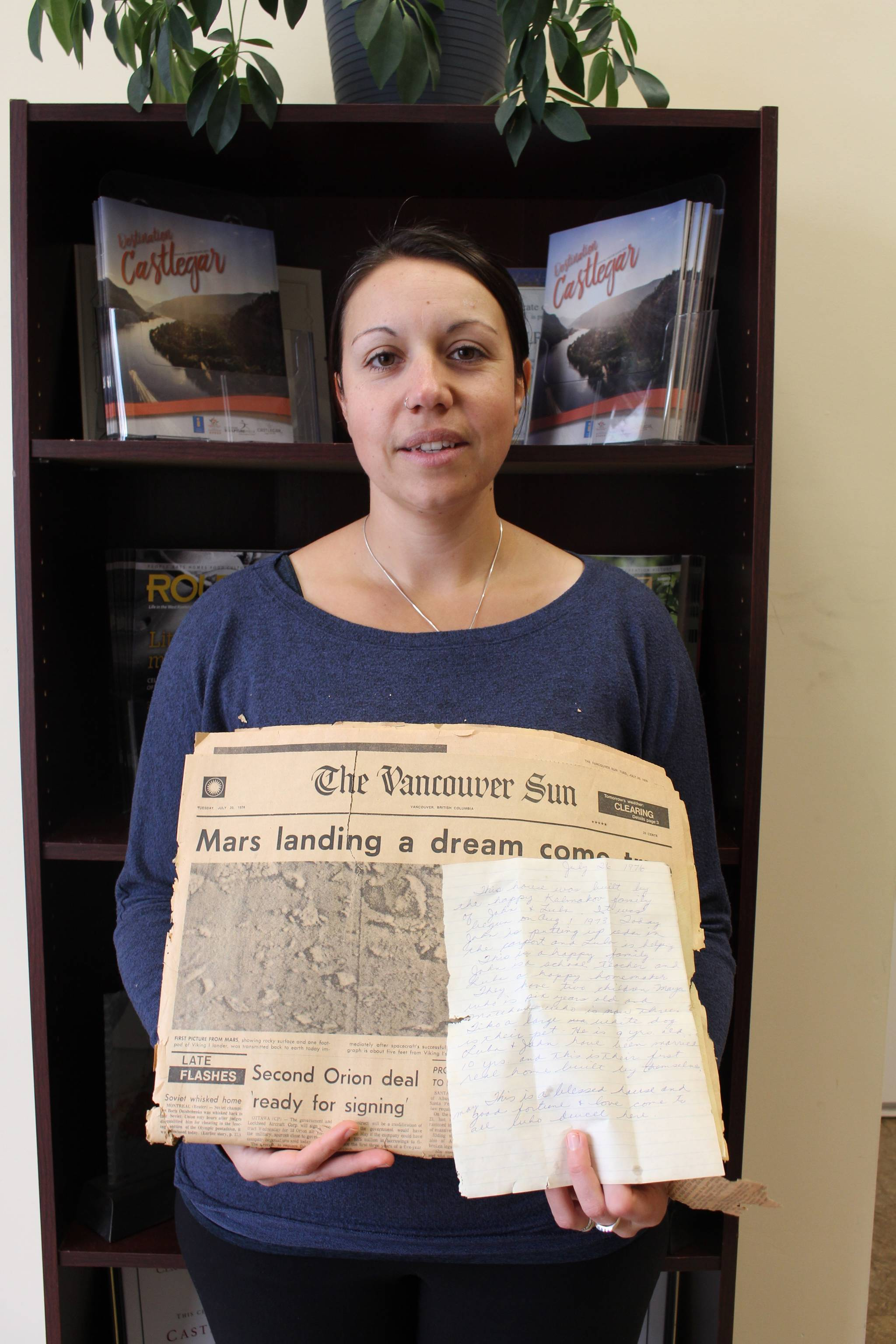 Fanny Rodgers shows the 45-year-old newspaper and letter left in the walls of her Castlegar home. Photo: John Boivin