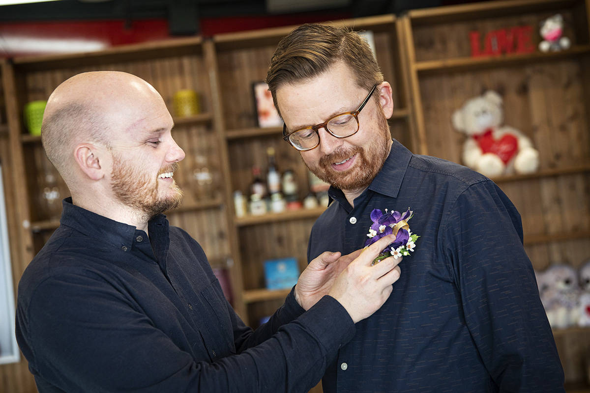 Richard Einarson, right, and his partner Mike Morrison shop for flowers for Saturday's upcoming ReProm fundraising gala in Calgary on Monday, February 24, 2020. Two decades after going to his high-school prom with his female best friend as a date, Morrison is about to get a re-do.This time, he'll be on the arm of his boyfriend of eight years, Einarson. THE CANADIAN PRESS/Todd Korol