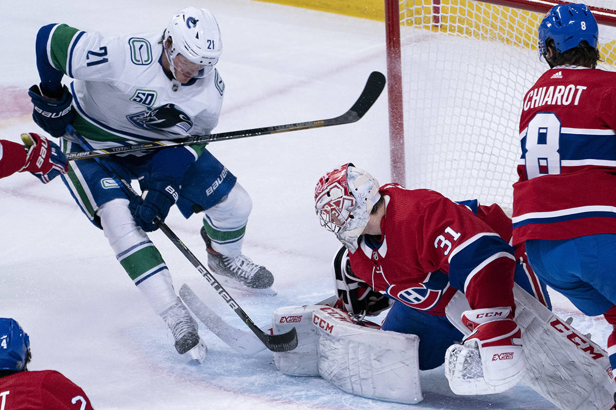 Montreal Canadiens goaltender Carey Price stops Vancouver Canucks' Loui Eriksson during first period NHL hockey action in Montreal, Tuesday, Feb. 25, 2020. THE CANADIAN PRESS/Paul Chiasson