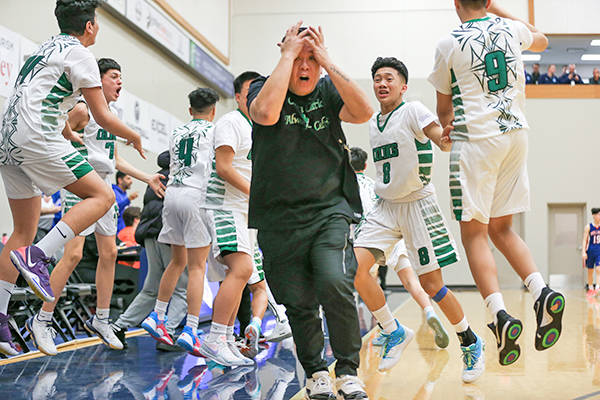 Celtics react to their win. St. Patrick defeated the Bulldogs 82-79 in the gold medal game final of the Junior Boys Basketball Provincial Invitational Tournament in Langley. The Tuesday night (Feb. 26) game wrapped up the four-day, 32-team competition. (Paul Yates/Vancouver Sports Pictures)