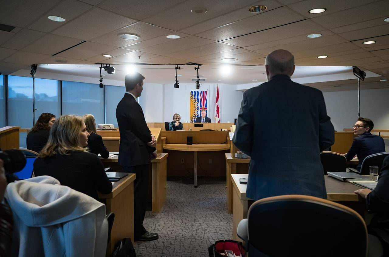 Commissioner Austin Cullen, back centre, listens to introductions before opening statements at the Cullen Commission of Inquiry into Money Laundering in B.C. in Vancouver, on Monday, February 24, 2020. THE CANADIAN PRESS/Darryl Dyck