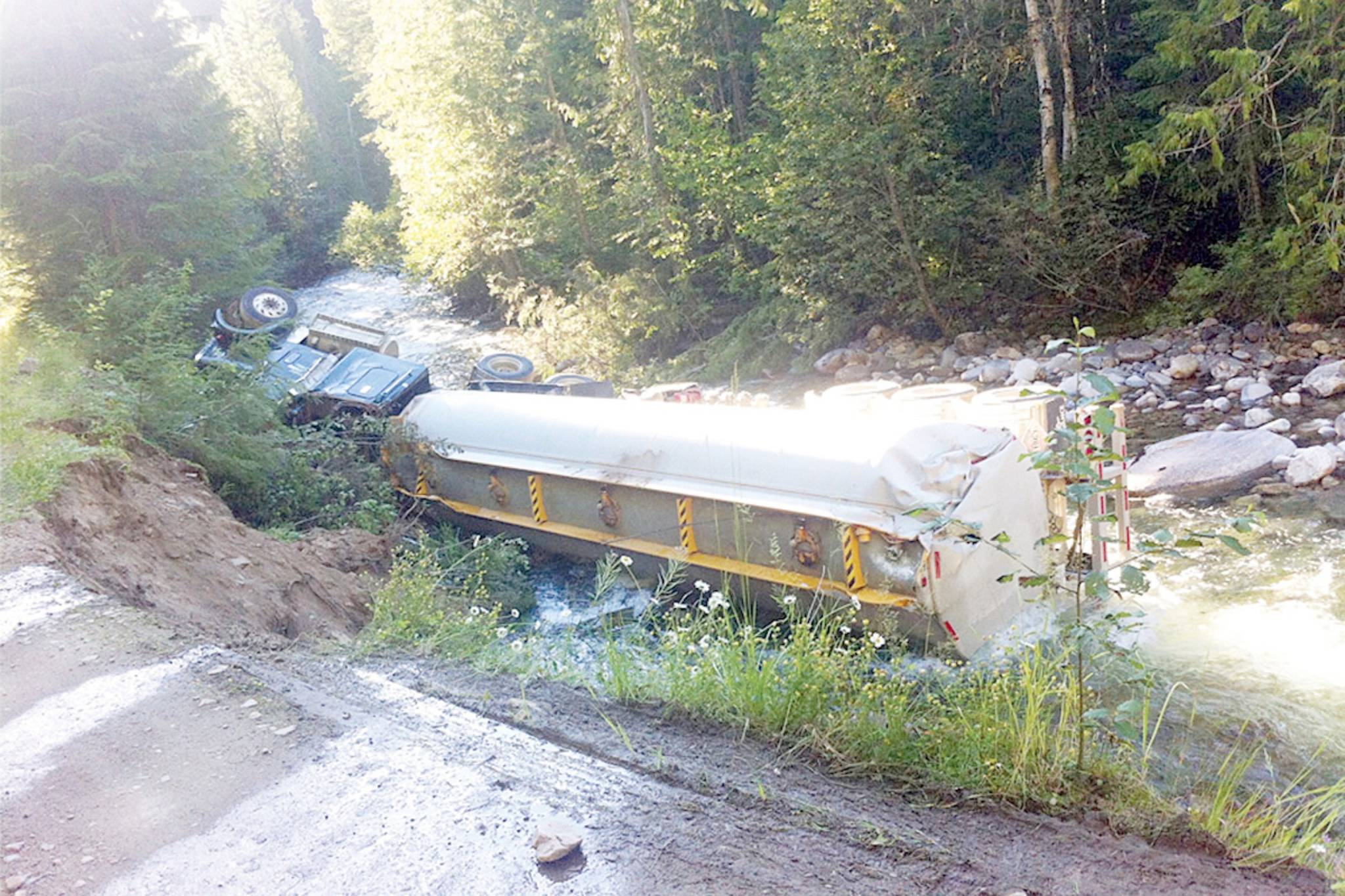 The fully-loaded fuel truck slipped off a forest service road and landed in Lemon Creek in July 2013. File photo