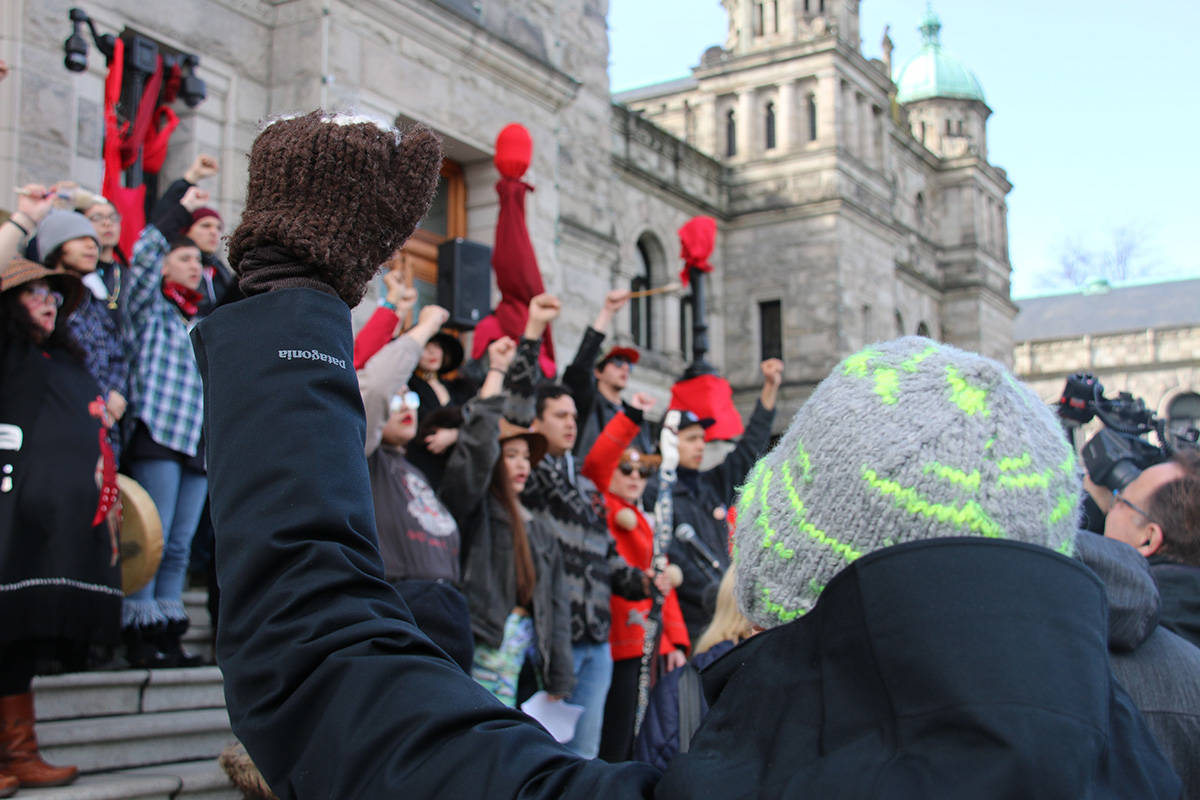 Arms raised in support of the Wet'suwet'en hereditary chiefs. (Kendra Crighton/News Staff)
