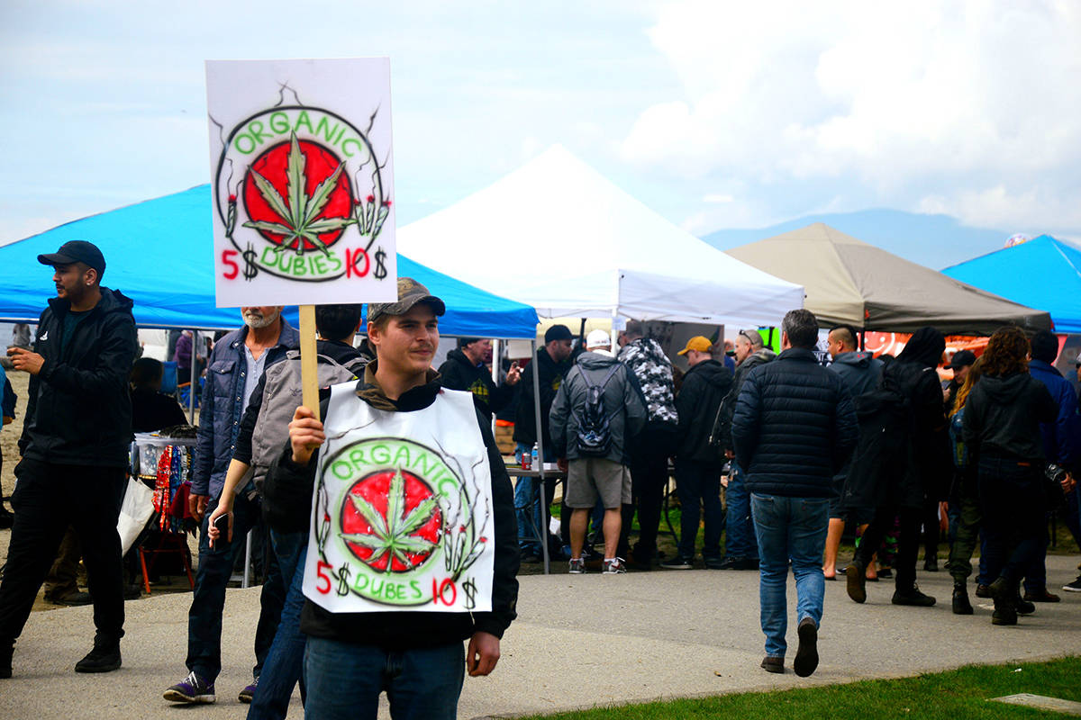 A man protests at a pre-legalization 4/20 protest at Sunset Beach in Vancouver on April 20, 2018. (Black Press Media files)