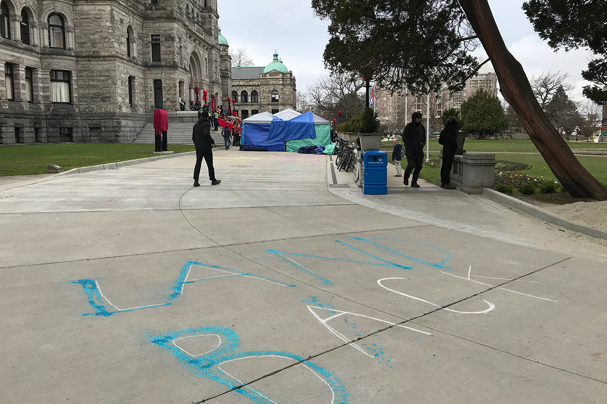 Two people were arrested at the BC Legislature for mischief after spraying chalk paint on the vicinity. (Kendra Crighton/News Staff)
