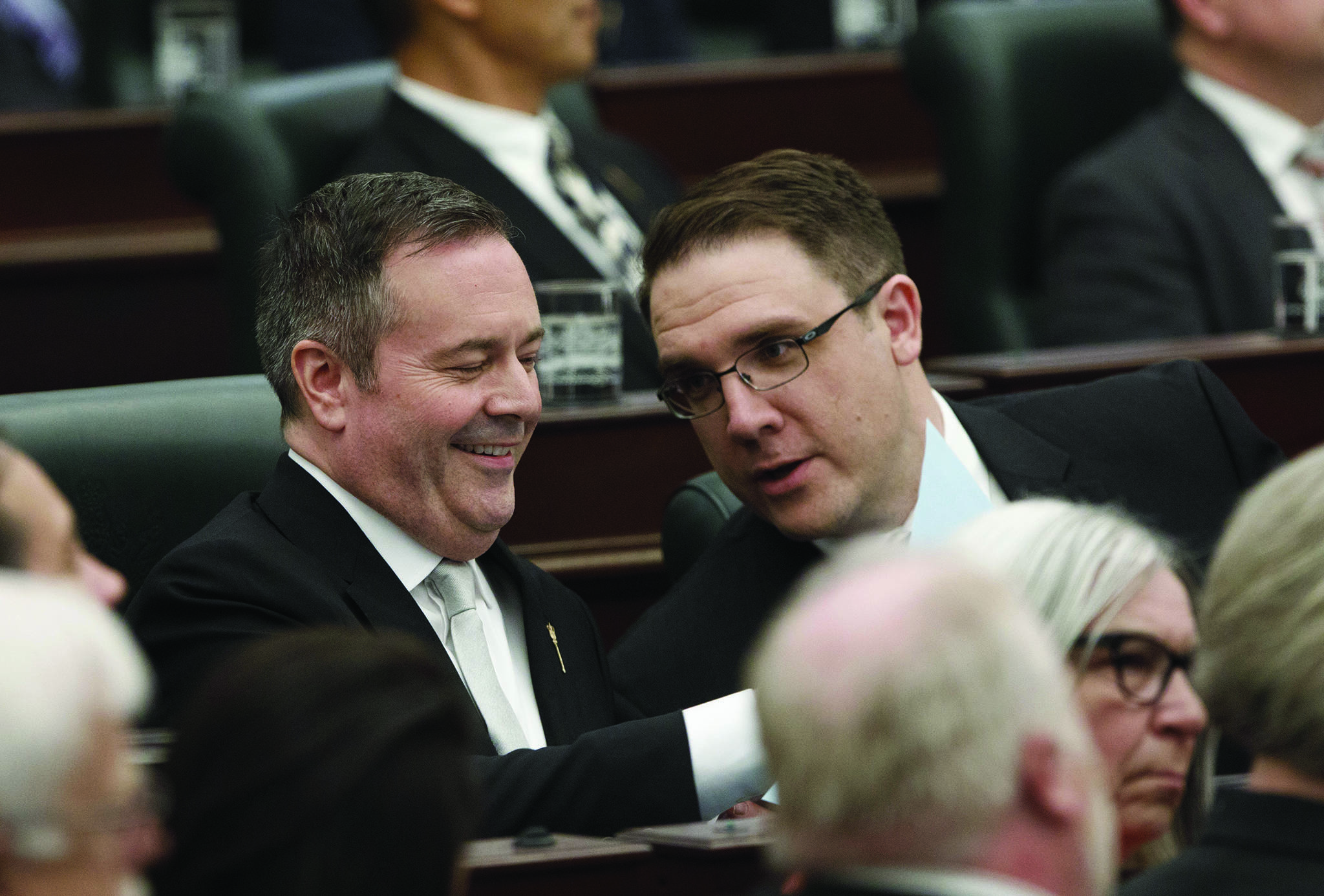 Alberta Premier Jason Kenney and Jason Nixon, Minister of Environment and Parks chat before the speech from the throne is delivered in Edmonton on Tuesday May 21, 2019. THE CANADIAN PRESS/Jason Franson