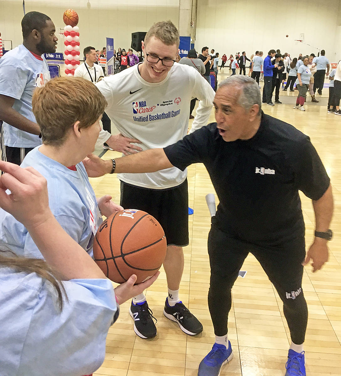 Sean Annan (centre) taught basketball to people with severe disabilities at the NBA Cares Special Olympics Unified Sports Basketball Game (Matthew Annan/special to Langley Advance Times).