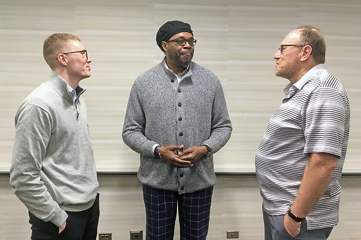 Sean Annan, Sam Perkins (left) and Matthew Annan (right) got a chance to chat with NBA great Sam Perkins at the NBA Cares Special Olympics Unified Sports Basketball Game in Chicago (Matthew Annan/special to Langley Advance Times).