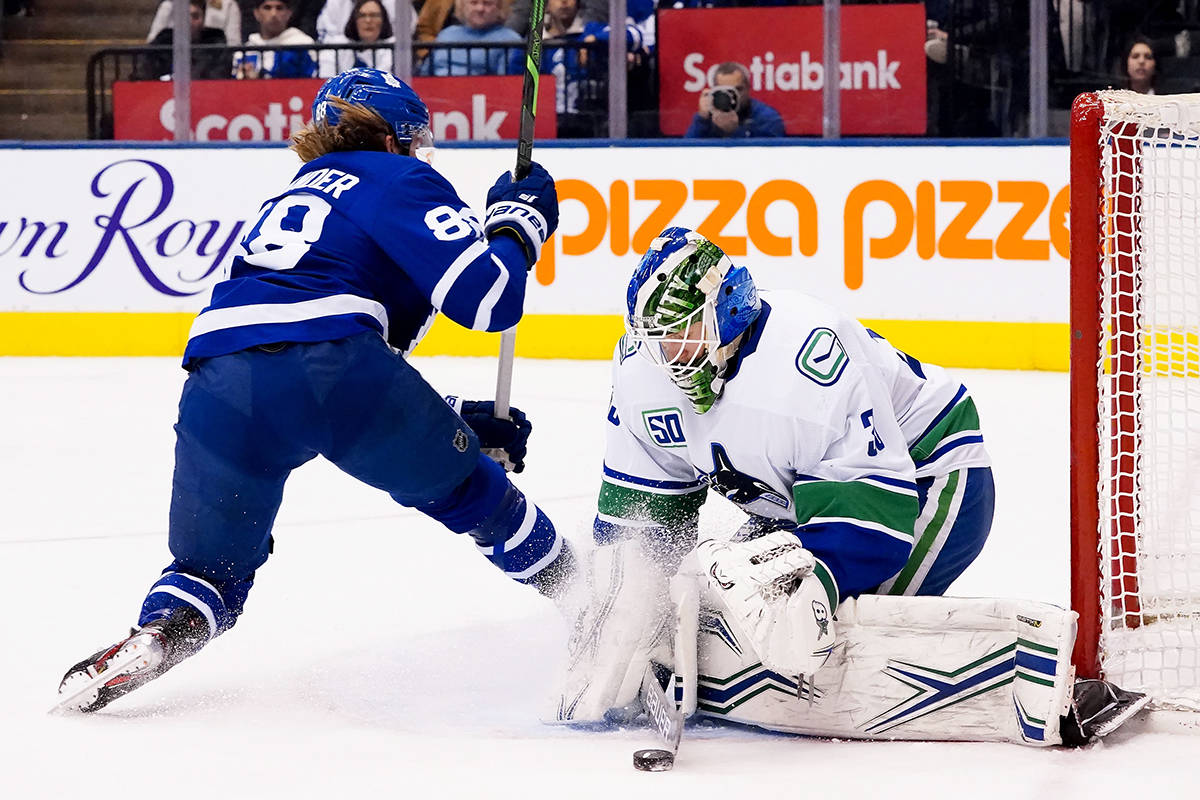 Vancouver Canucks goaltender Thatcher Demko (35) stops Toronto Maple Leafs right wing William Nylander (88) during second period NHL hockey action in Toronto, Saturday, Feb. 29, 2020. THE CANADIAN PRESS/Frank Gunn