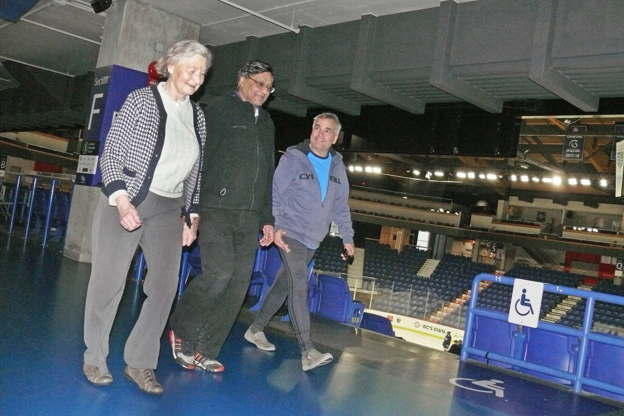 Ingeborg Horst (left) chats with fellow walkers at Langley Events Centre. Raymond Kleiner is on the right. (Dan Ferguson/Langley Advance Times)