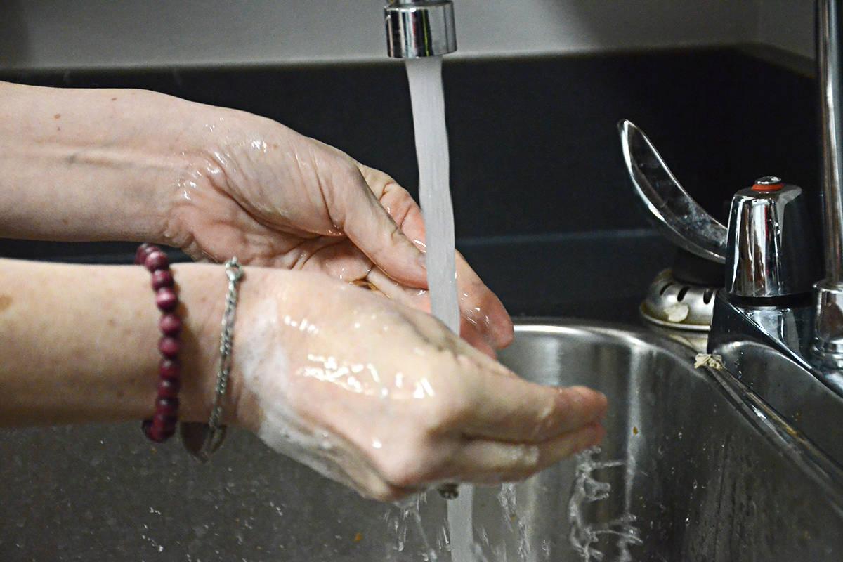 Emergency program coordinator Ginger Sherlock displays the best method of preventing viral transmission – regular hand washing. (Matthew Claxton/Langley Advance Times)