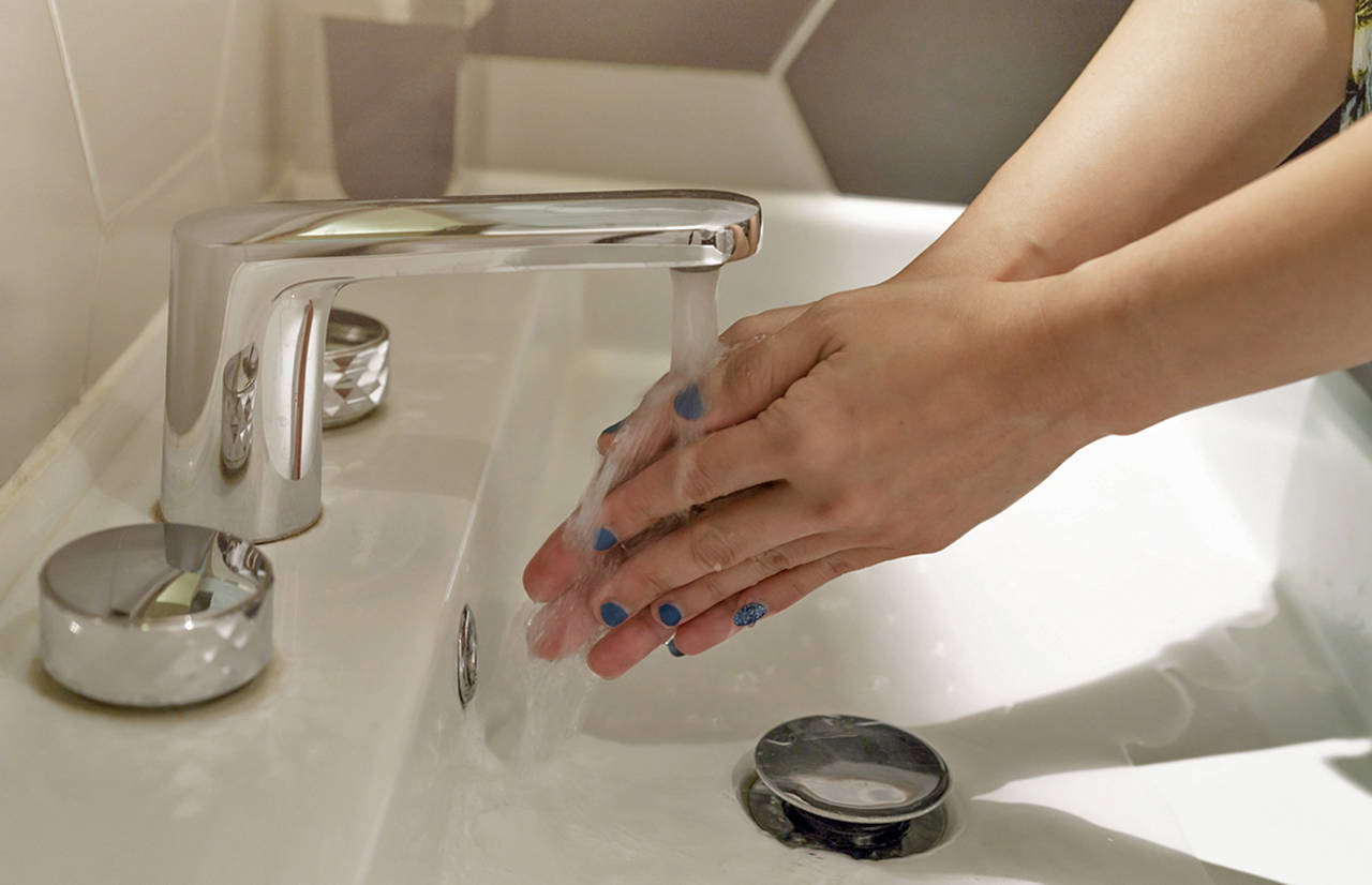Washing your hands frequently and staying home when you're feeling ill is more effective than facemasks in controlling the spread of a virus. (Black Press Media file)