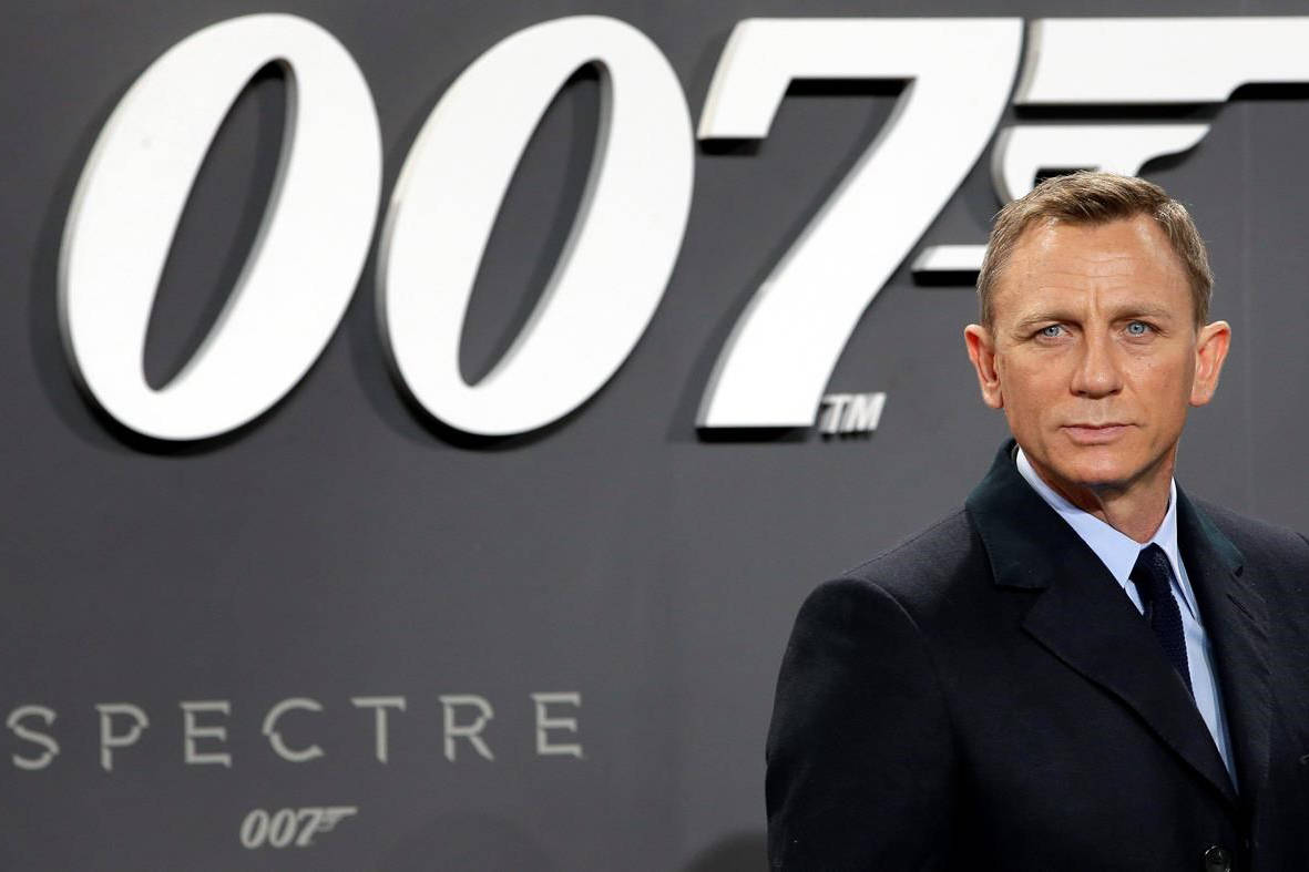 "FILE - This is a Wednesday, Oct. 28, 2015 file photo of actor Daniel Craig poses for the media as he arrives for the German premiere of the James Bond movie 'Spectre' in Berlin, Germany. The release of the James Bond film ""No Time To Die"" has been pushed back several months because of global concerns about coronavirus. (AP Photo/Michael Sohn/File)"