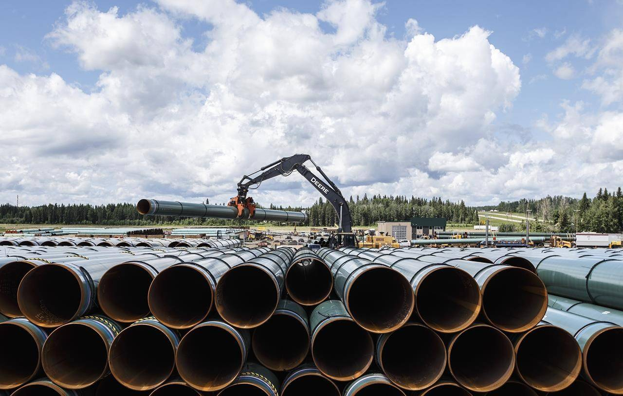 Pipe for the Trans Mountain pipeline is unloaded in Edson, Alta., Tuesday, June 18, 2019. The Trans Mountain pipeline expansion has cleared another legal hurdle. The Supreme Court of Canada has dismissed five leaves to appeal mounted by environment and Indigenous groups, all of which wanted the court to hear arguments about whether cabinet's decision to approve the pipeline violated the Species at Risk Act due to fears the project would harm the highly endangered southern resident killer whales. THE CANADIAN PRESS/Jason Franson