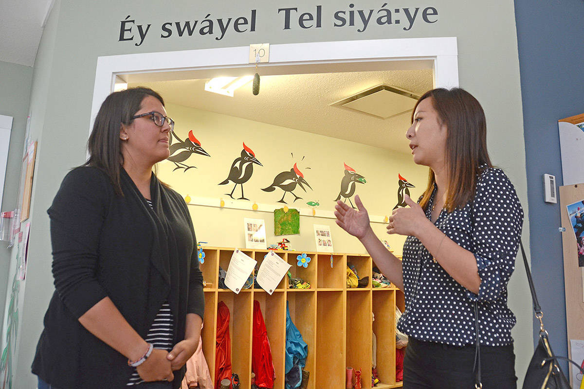Sto:lo (À:lmèlhàwtxw) Early Education Centre supervisor Jenn Carman (left) speaks with Minister of State for Child Care, Katrina Chen on June 29, 2018 during Chen's visit to Chilliwack. (Paul Henderson / The Progress.)