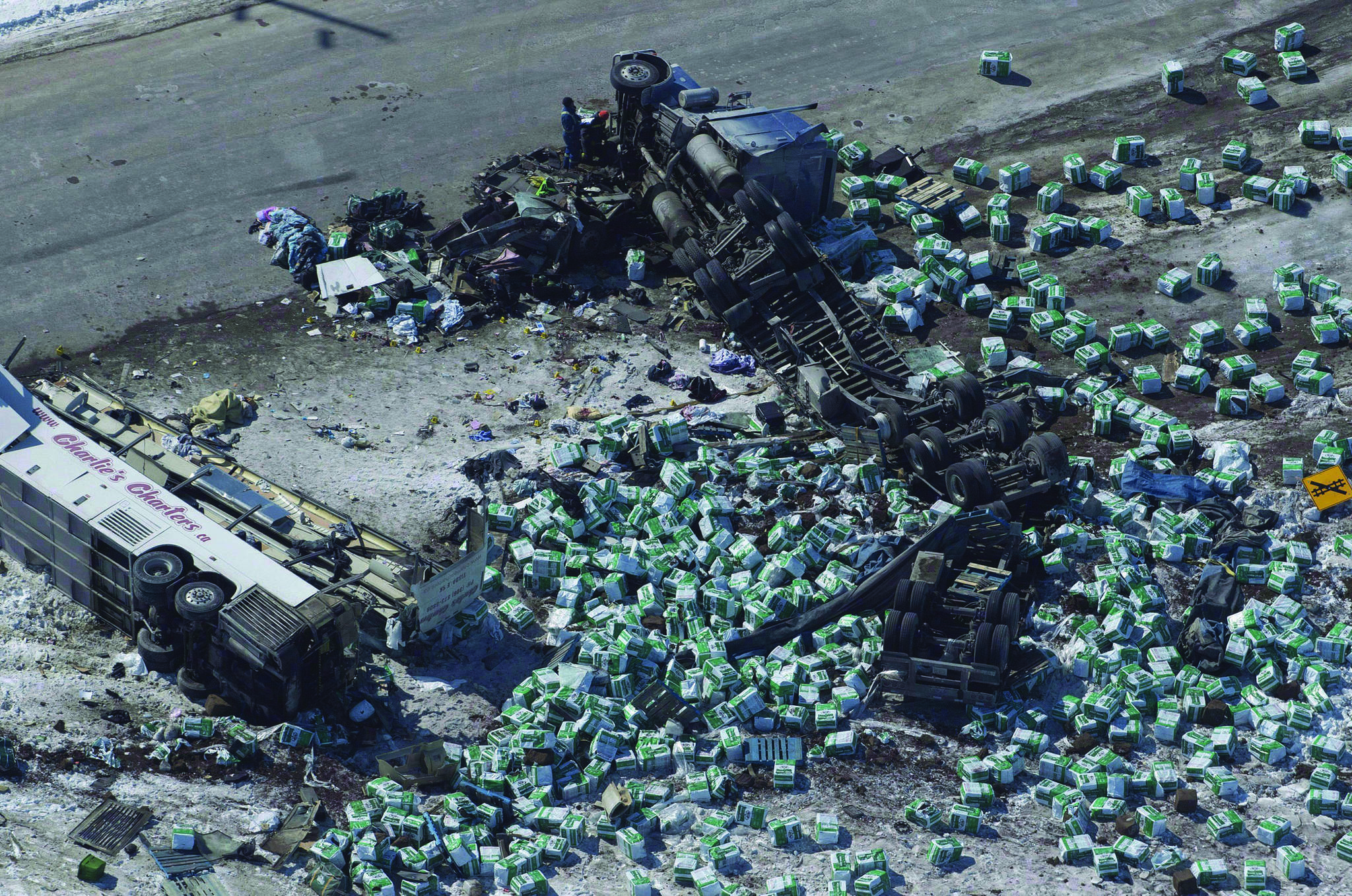 The wreckage of a fatal crash outside of Tisdale, Sask., is seen Saturday, April, 7, 2018. Saskatchewan RCMP say they are preparing to talk to Crown prosecutors about potential charges in the Humboldt Broncos bus crash as its investigation continues. Police say they are still analyzing the data and evidence gathered from the scene of the April 6 collision between the bus and a semi-truck. THE CANADIAN PRESS/Jonathan Hayward