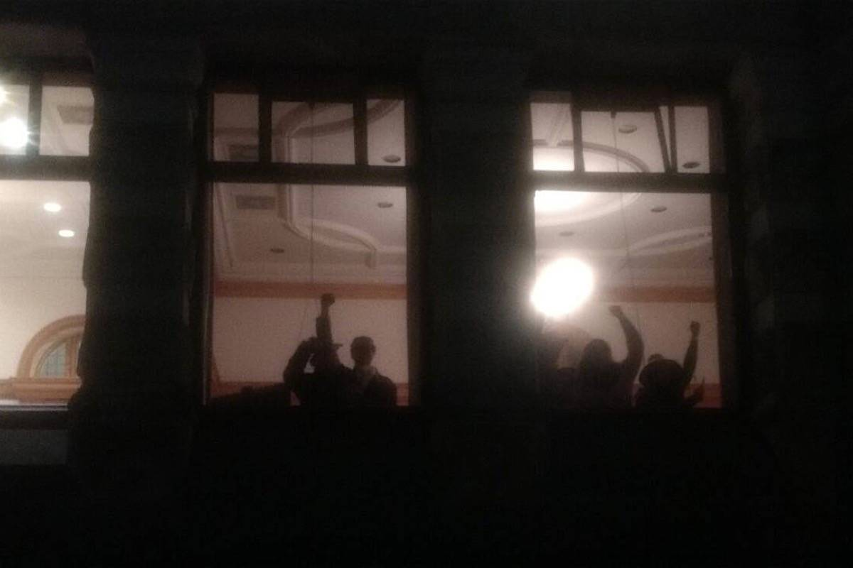 Protesters occupy the Indigenous relations ministry offices at the B.C. legislature late Wednesday, March 4, 2020, posting social media messages from inside and outside as they called for support to help stop Victoria Police from removing them. (Twitter)