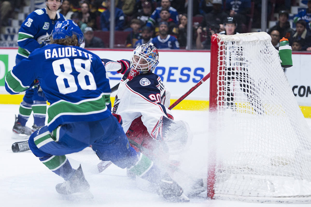 Vancouver Canucks centre Adam Gaudette (88) fails to get a shot past Columbus Blue Jackets goaltender Elvis Merzlikins (90) during second period NHL action in Vancouver, Sunday, March 8, 2020. THE CANADIAN PRESS/Jonathan Hayward