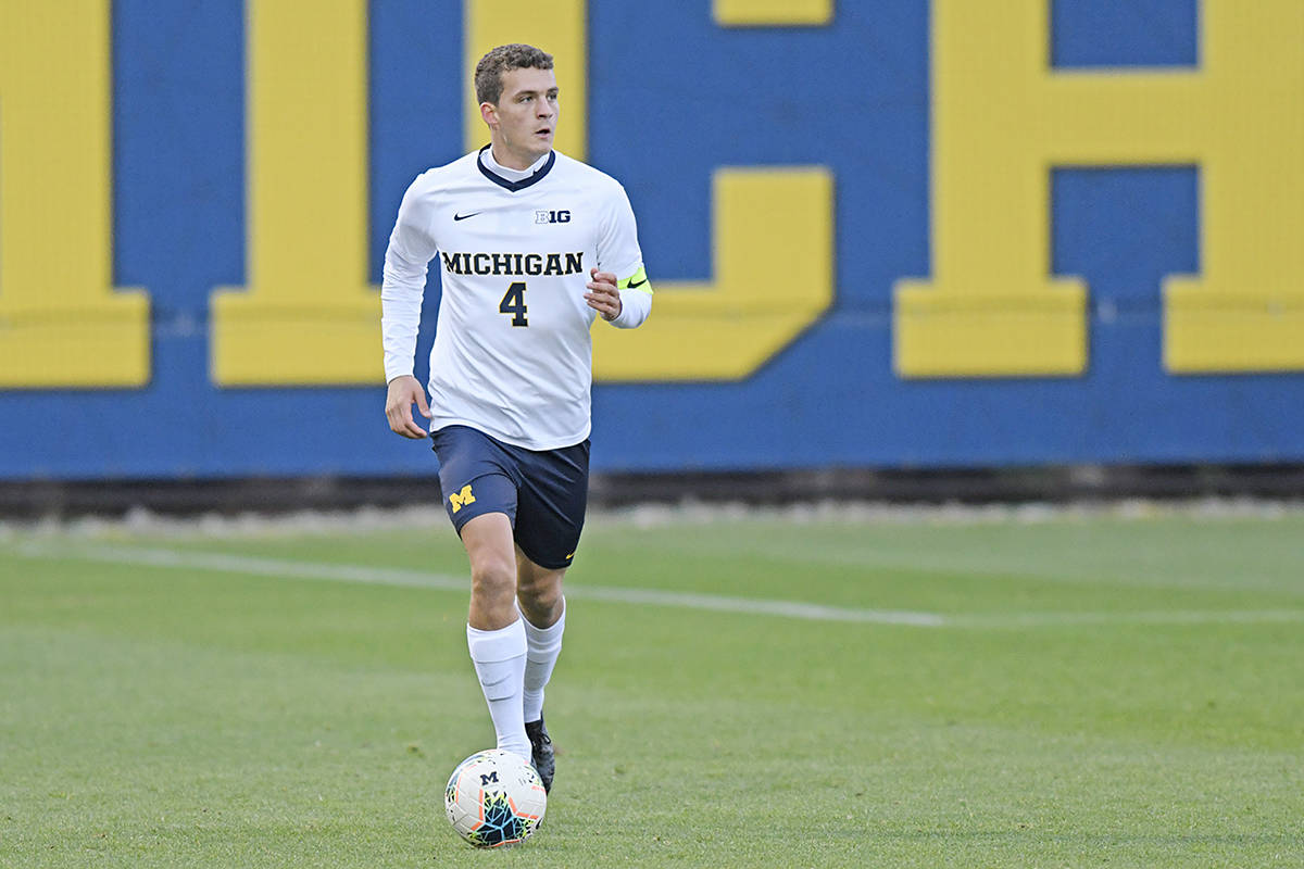 Joel Harrison, seen here on the University of Michigan men's soccer team playing against Wisconsin at the U-M Soccer Stadium in Ann Arbor, Mich., on Friday, Oct. 25, 2019, came back from serious injuries that took 22 months for him to recover (U-M Photography/special to Langley Advance Times)