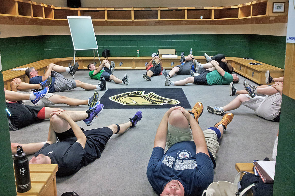 Participants in a recent Hockey FIT program started a workout by stretching in a pro hockey team dressing room. (Hockey FIT image/special to Langley Advance Times)