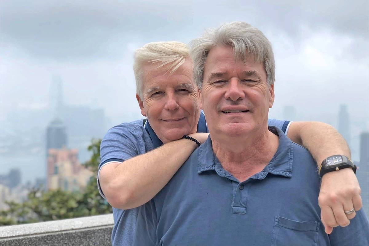 Nigel Finch-Cole (left) and Patrick Cole pose for a photo during a stop in Hong Kong Jan. 25 – nine days before their cruise ship was placed under quarantine. (Contributed photo)