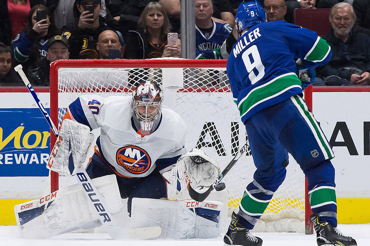 Vancouver Canucks' J.T. Miller (9) scores the only goal of the shootout against New York Islanders goalie Semyon Varlamov, of Russia, during an NHL hockey game in Vancouver, on Tuesday, March 10, 2020. THE CANADIAN PRESS/Darryl Dyck