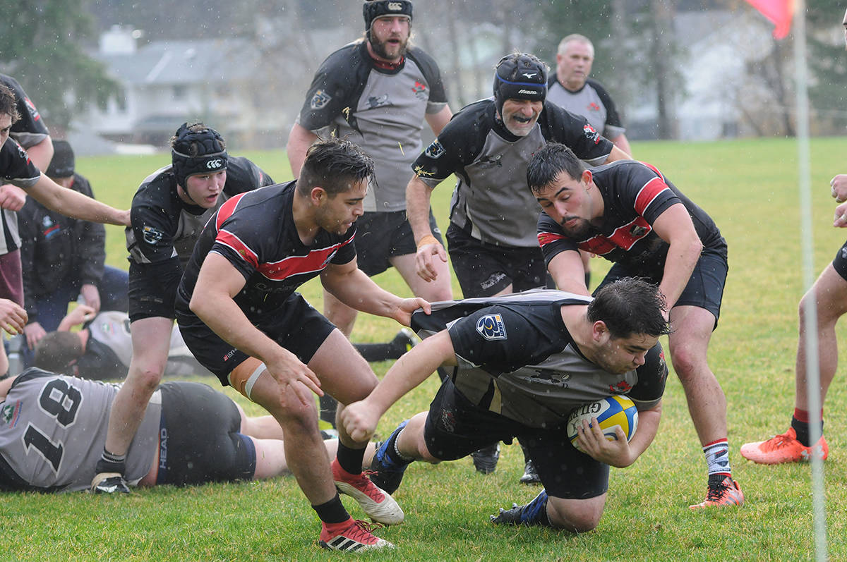 A pair of Abbotsford RFC defenders resort to holding a Black Sheep player's jersey to stop him from advancing toward the end zone, midway through a B.C. Rugby Union game in December 2018 at the Port Alberni rugby club. Abbotsford won 45-32. SUSAN QUINN PHOTO