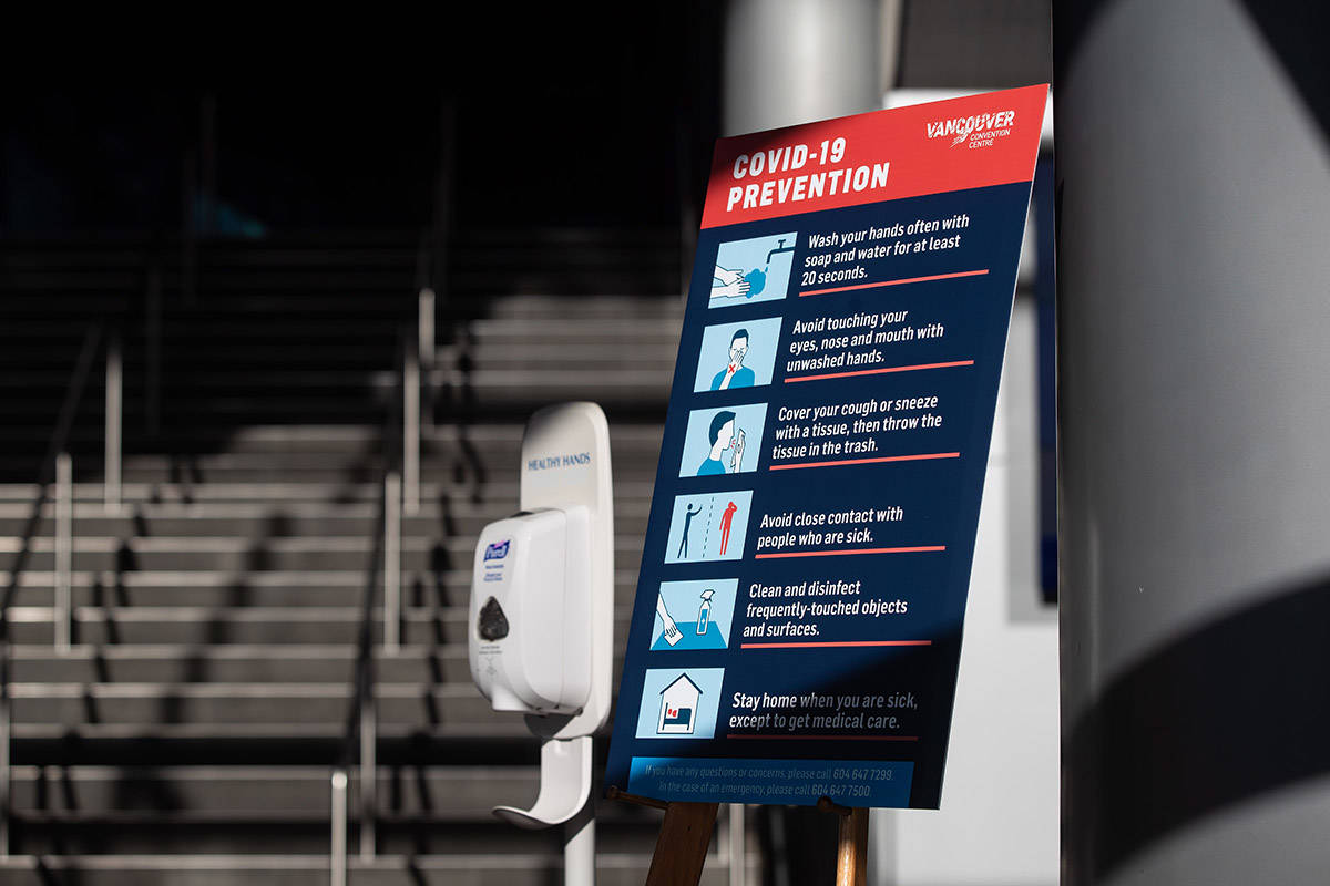 A hand sanitizer dispenser and a sign indicating steps to be taken to limit the spread of the novel coronavirus COVID-19 is seen at an entrance to the Vancouver Convention Centre, in Vancouver, on Saturday, March 14, 2020. THE CANADIAN PRESS/Darryl Dyck
