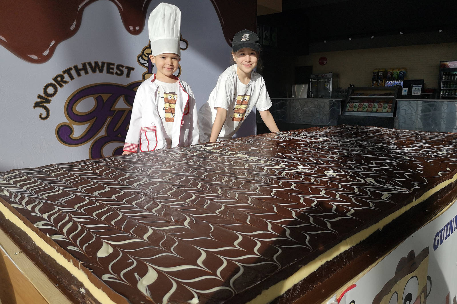 Austin Kurtis, 5, left, and his big sister Ella, 10, of Levack, Ont., helped create a 240-kilogram (530-pound) Nanaimo bar for a Guinness World Records attempt. (Photo submitted)