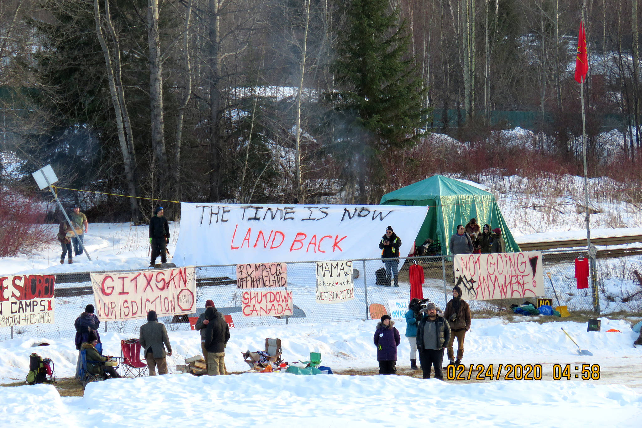 FILE - In this file photo, members of the Gitxsan Nation resurrect their blockade of the main CN rail line in New Hazelton Feb. 24. A new Research Co. poll released Tuesday, March 17, 2020 suggests most B.C. residents support carrying on with construction of the Coastal GasLink natural gas pipeline in northern B.C. (Randall Shoop photo)