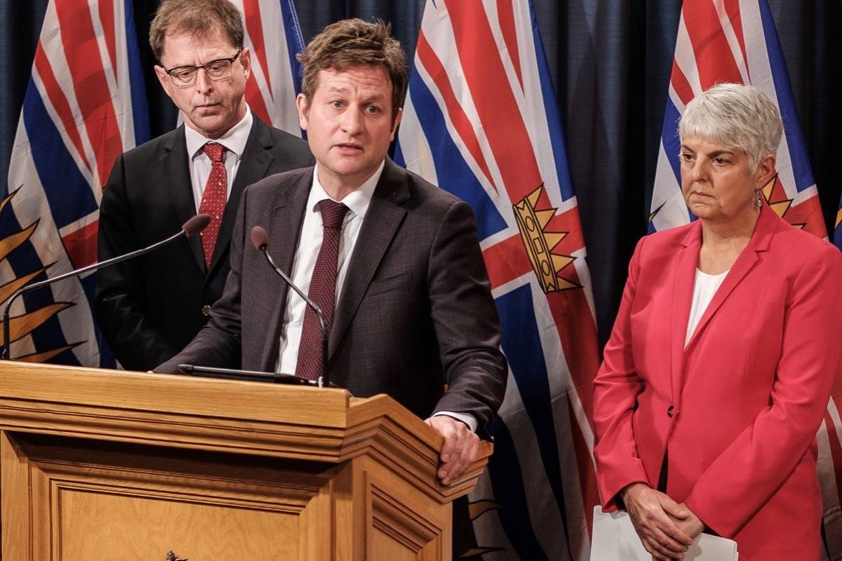 FILE – B.C. Health Minister Adrian Dix, Education Minister Rob Fleming and Finance Minister Carole James at the B.C. legislature in November 2019. (Province of B.C.)