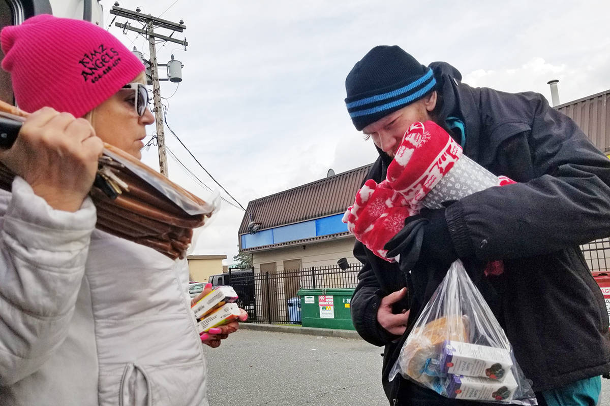 Kim Snow of Kimz Angels, seen here distributing food and essentials to the homeless in Langley on March 1, now wears a mask and gloves. She said panic buying has depleted supplies of disinfectant wipes. (Dan Ferguson/Langley Advance Times)
