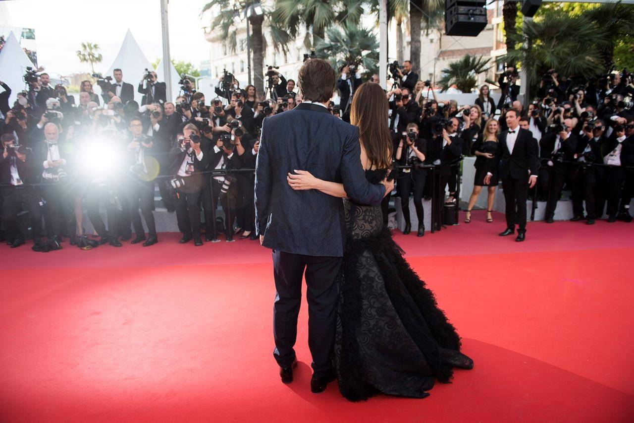FILE - In this May 8, 2018 file photo, actors Penelope Cruz, right, and Javier Bardem pose for photographers at the opening ceremony of the 71st international film festival, Cannes, southern France. Arguably the world's most prestigious film festival and cinema's largest annual gathering has postponed its 73rd edition. Organizers of the French Riviera festival, scheduled to take place May 12-23, said they are considering moving the festival to the end of June or the beginning of July. (Photo by Arthur Mola/Invision/AP, File)