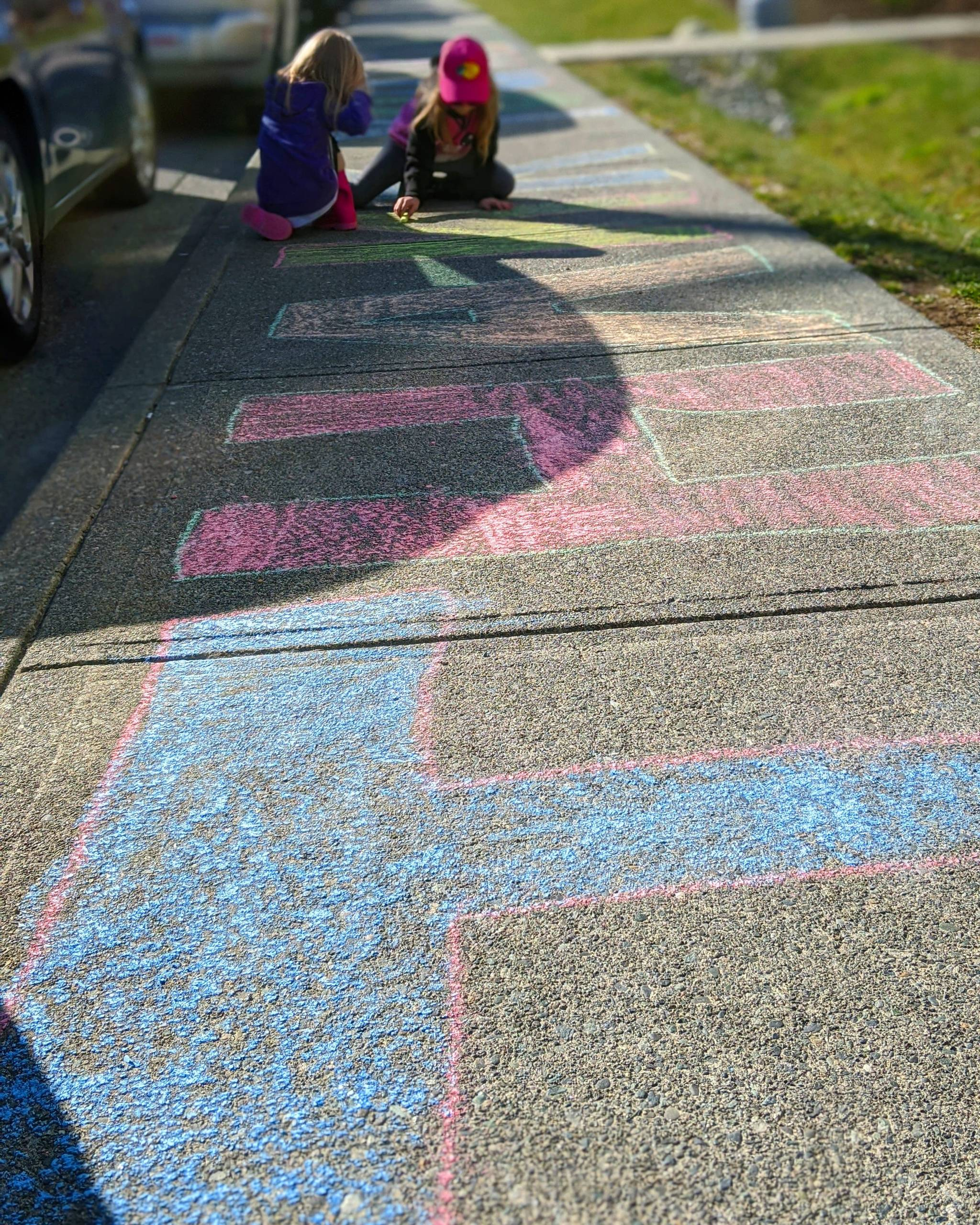 Sisters Kaila and Chloe Weaver create a chalk art thank-you message for Campbell River Hospital staff on March 18, 2020. Photo courtesy of David Weaver