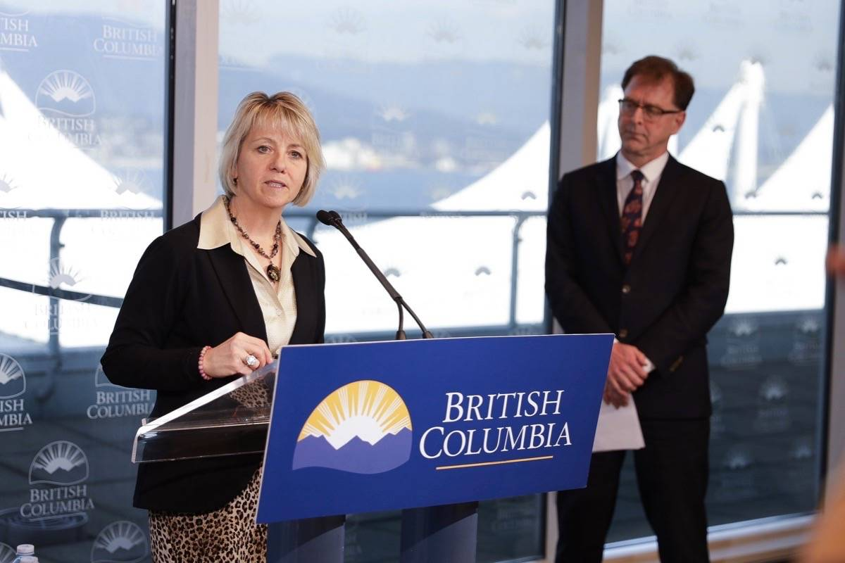 Provincial Health Officer Dr. Bonnie Henry and B.C. Health Minister Adrian Dix observe physical distance rules while giving latest statistics on COVID-19 pandemic, Vancouver, March 19, 2020. (B.C. government)