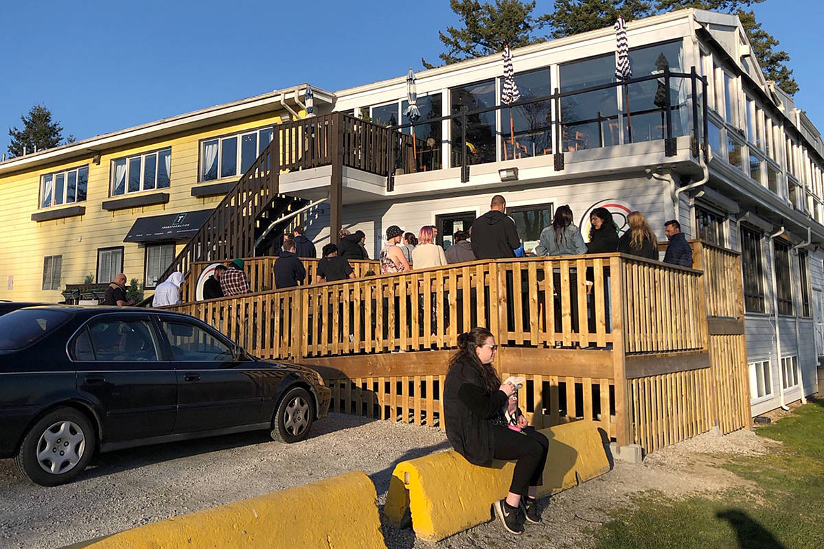 A lineup forms outside White Rock cannabis dispensary, Indigenous Bloom. (Contributed photo)