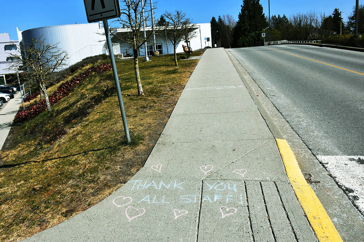 The postiive affirmations continued on the sidewalks leading from the parking lot to the hospital entrance. (Ronan O'Doherty - THE NEWS)