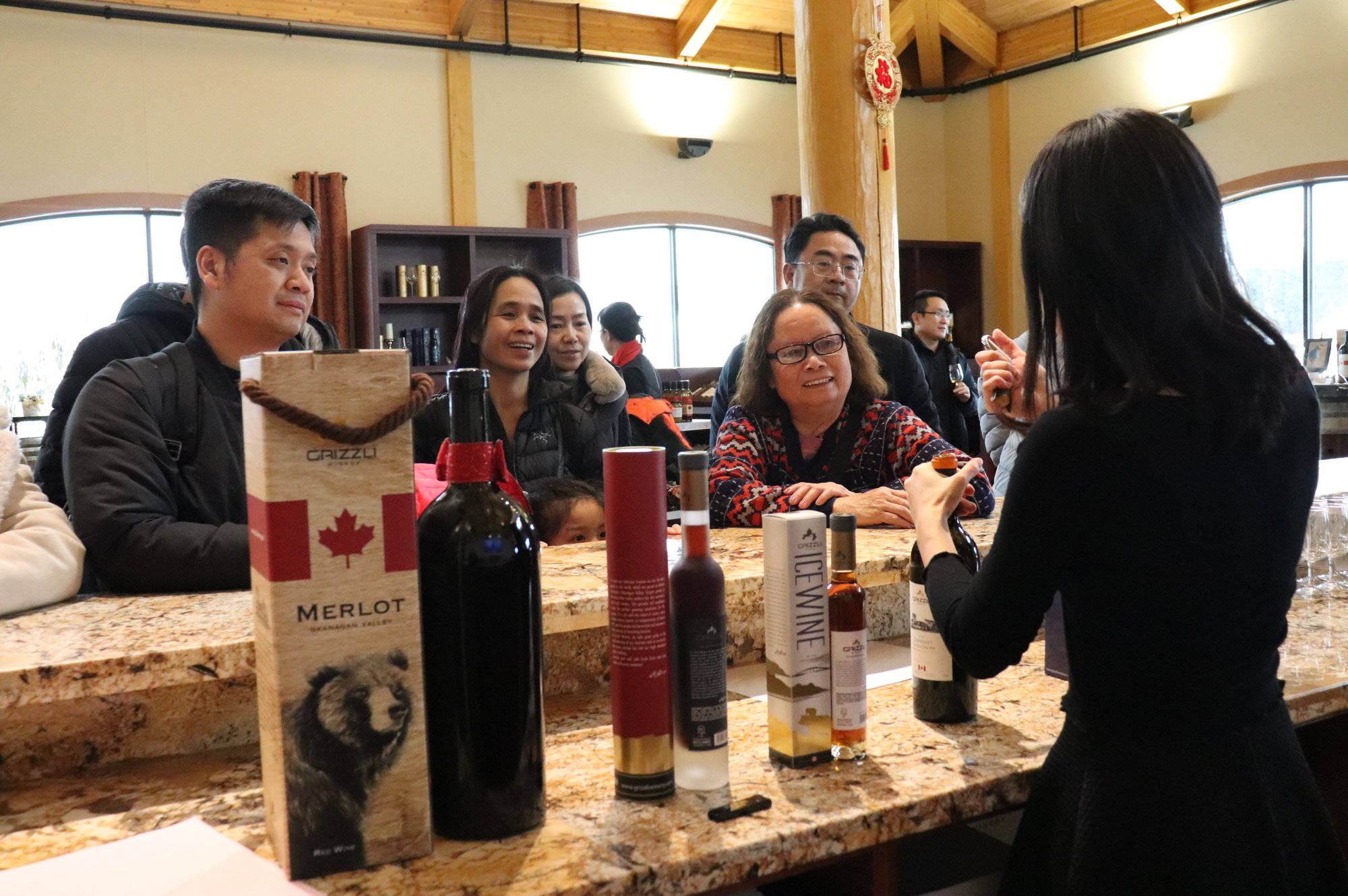 Tourists learn about icewines and table wines produced in the Okanagan on Jan. 24, 2020. (Twila Amato - Black Press Media)