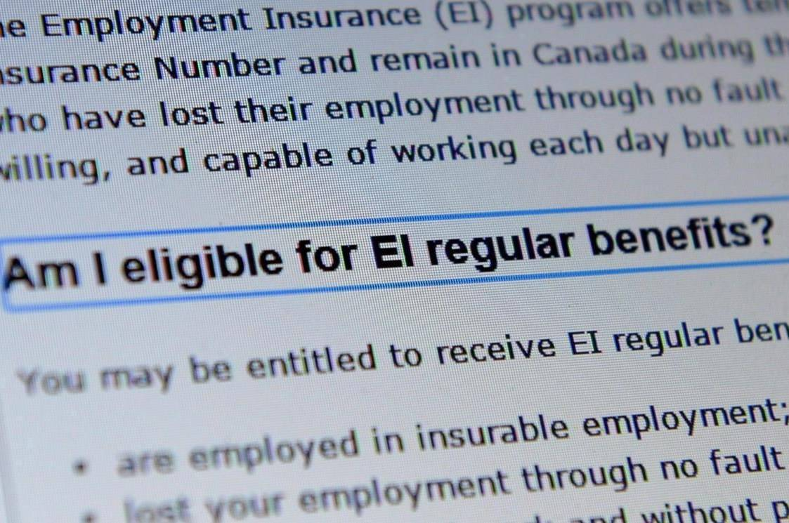 FILE – Canada Service centre documents that display Employment Insurance options are pictured in Ottawa on Tuesday, July 7, 2015. THE CANADIAN PRESS/Sean Kilpatrick