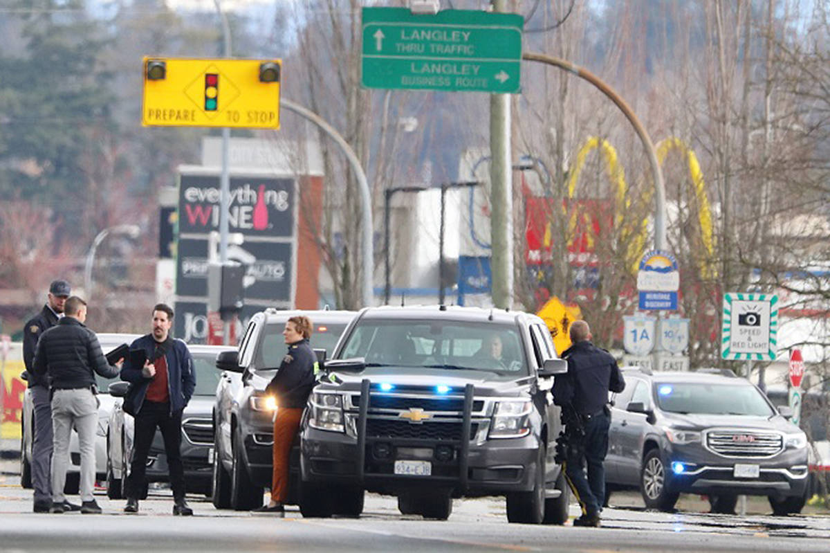 Police at the scene of an incident on Tuesday, March 24th, where a man fell from an overpass in Langley. (Shane MacKichan/special to Langley Advance Times)