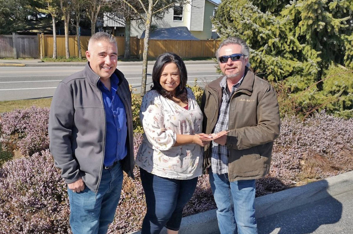 Aldergrove Poker Night founder Jodi Mangat (middle) handed Elks Association member Len George (right) and community police liasion, Cpl. Kurt Neuman, $1,000 for local families on March 18. (Jodi Mangat/Special to the Aldergrove Star)