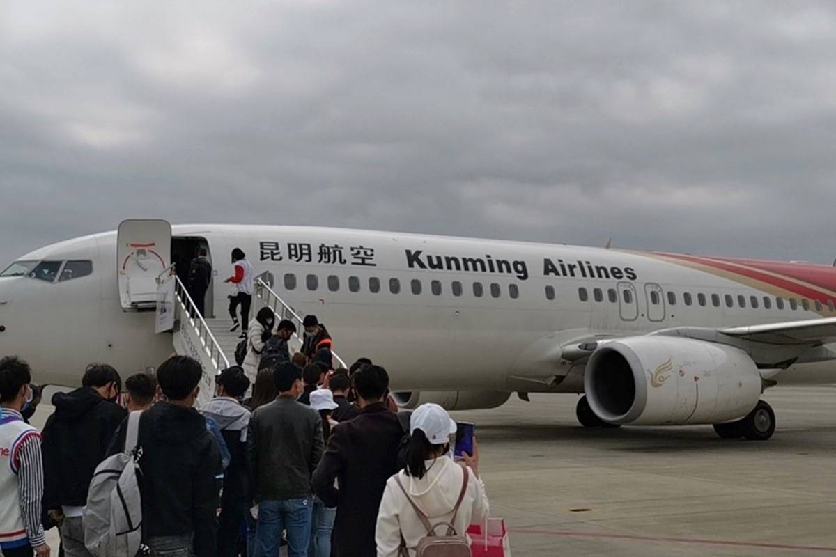 Boarding the plane in Kunming, where former Parksville resident Mark Conway had his layover on his journey back to China. (Submitted photo)