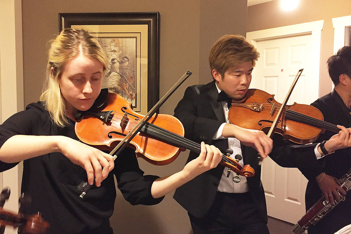"Musicians perform during a Surrey City Orchestra ""mixer"" at board member Erin Anne Beirne's home in South Surrey in 2017. (File photo: Tom Zillich)"