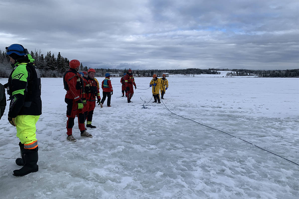 The BC Search and Rescue Association is urging the public to take extreme caution if going into the outdoors during the COVID-19 pandemic. Here search and rescue members practice ice rescue training in the Cariboo weeks before the virus showed up in B.C. (Photo submitted)
